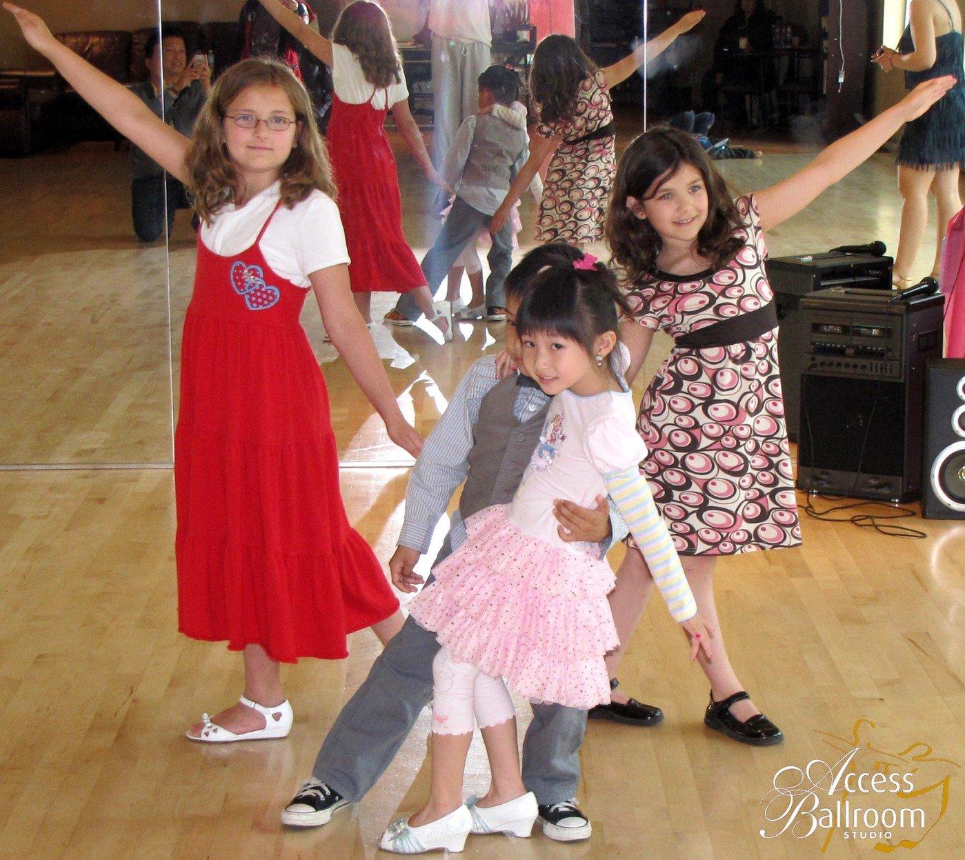 kids dance lessons toronto access ballroom kids and teens ballroom dance lessons four 4 kids taking dance poses kids dip asian boy asian girl two white girls