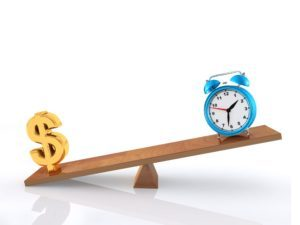 clock and dollar sign on a seesaw symbolizing balance vs work ethic