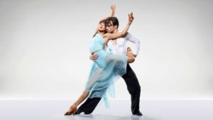 dna ballroom dancers in a pose an example of how the history of waltz has evolved