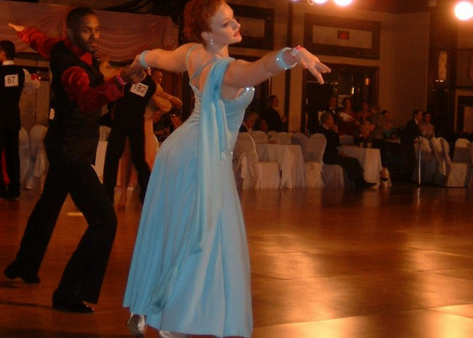 couple dancing at dance competition ballroom latin smooth dance style